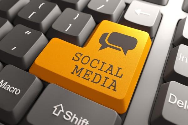 Social Media. Orange Button on Computer Keyboard. Social Media Concept.