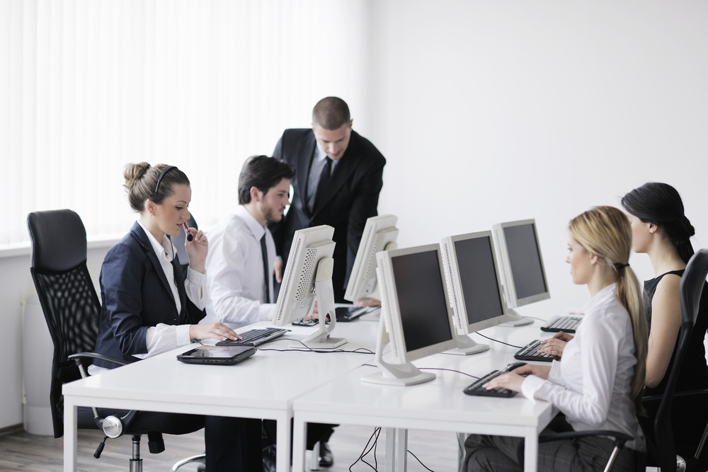 business people group with  headphones giving support in  help desk office to customers, manager giving training and education instructions-2
